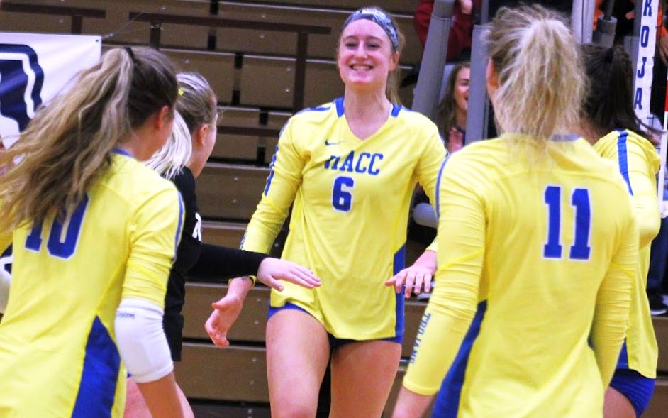 NIACC's Kennedy Meister bumps the ball over the net in Friday's match against Dakota College-Bottineau.