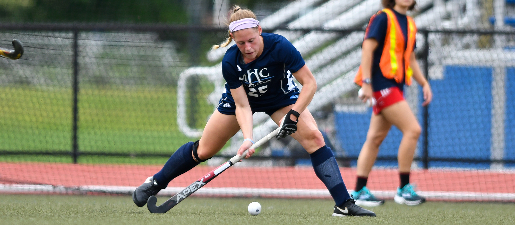 Action photo of Lyons field hockey player, Laurissa Montigny.