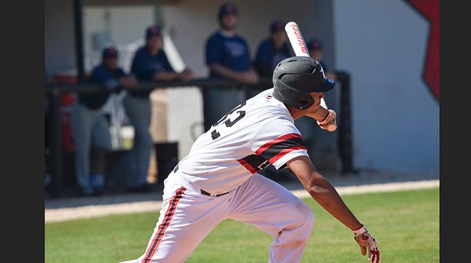 Isaiah Cullum singles to drive in the winning run in the bottom of the ninth as the Eagles beat South Florida 3-2. (Photo by Tom Hagerty, Polk State.)