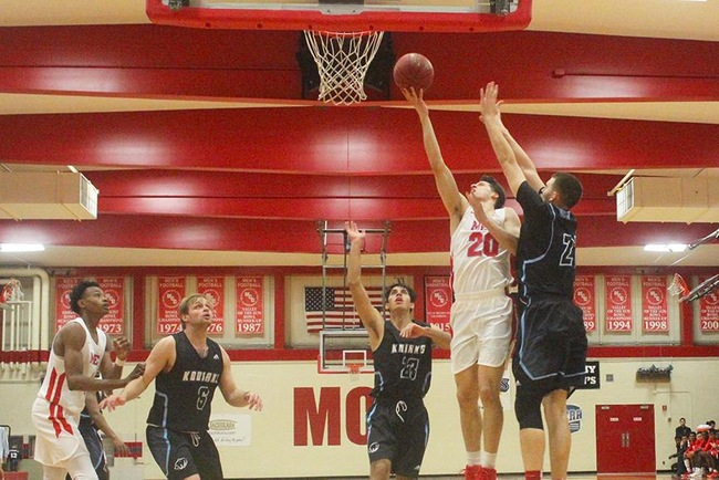 Mesa's Bryce Cheney (#20) finger rolls two of his game high 18 points in the T-Birds win Monday night.