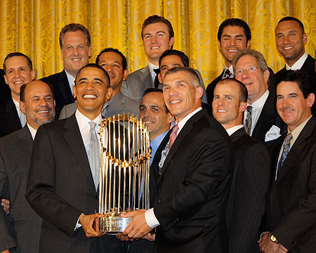 President Obama with the New York Yankees and the World Series  trophy.