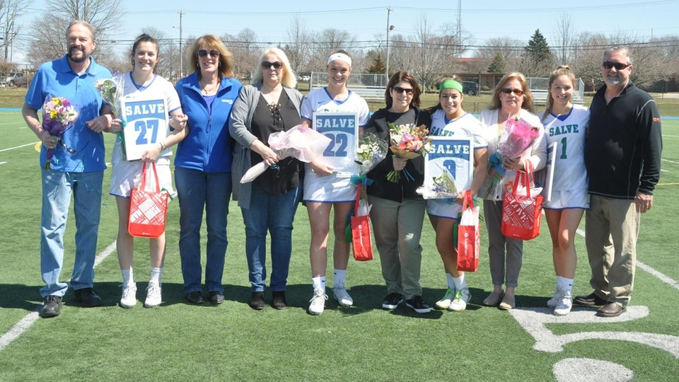 Salve Regina honored their four seniors Lindsey Smith, Kerri Beland, Victoria Johnson, and Olivia Slysz (l-r) before its 22-7 victory over Nichols.