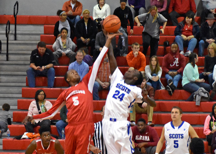 Jerrod Pettus leaps for the opening tipoff in Saturday's game with Covenant.