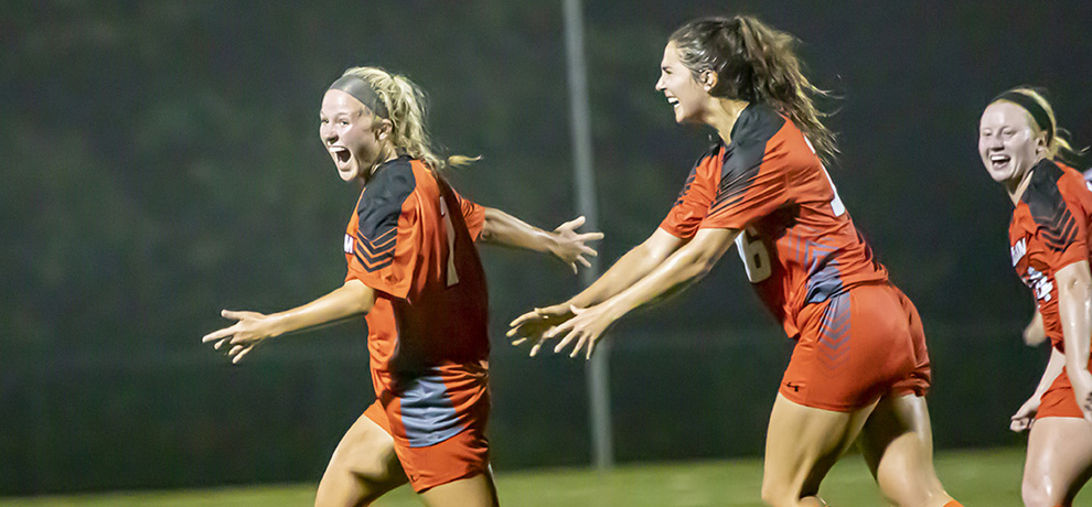 Ellie Tomassoni celebrates her go-ahead goal against Young Harris with teammates Kate Guildford and Kaitlyn Watson (photo by Chuck Williams)