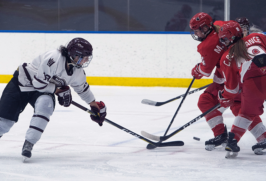 Chantal Ricker, seen battling against SAIT on Friday night in Edmonton, scored one of MacEwan's five goals in a 5-2 victory over the Trojans in Calgary on Saturday (Matthew Jacula photo).