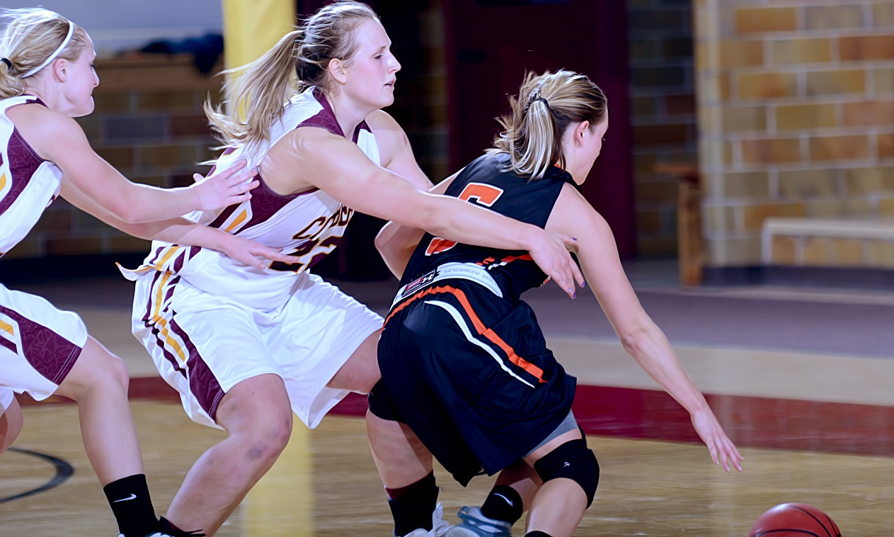 Olivia Johnson (#22) and Greta Walsh go for the steal late in the fourth quarter in Concordia's thrilling game with Jamestown.