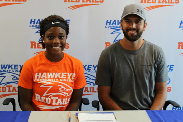 Hawkeye RedTails Track and Field recruit Theresa Hatch with RedTails associate head coach Tyler Mulder.
