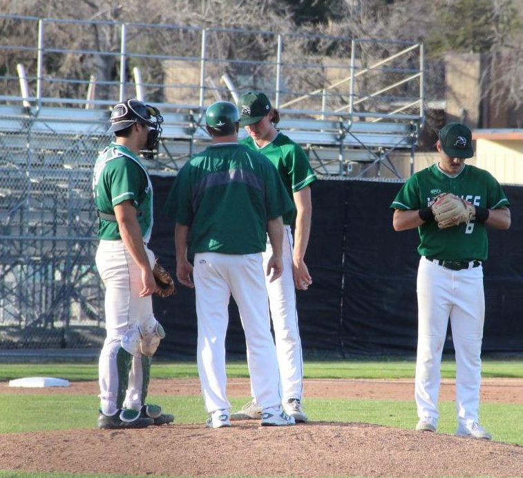 A mound visit occurs after reliever Decklan Cashman gives up a key hit in the eighth inning against College of Marin at Diablo Valley College in Pleasant Hill, California on February 1, 2018.