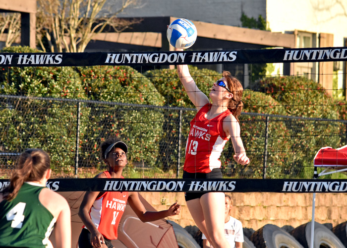 Lexie DeVuyst (#13) and Alex Hillman (#11) won a three-set match on Saturday to help the first-year Huntingdon beach volleyball team clinch its first team win. (Photo by Wesley Lyle)