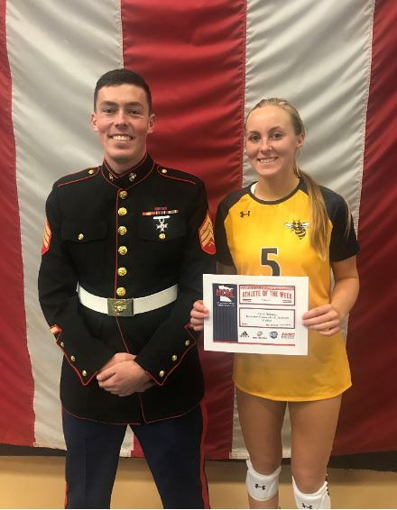 United States Marine Corps Sergeant Peterson presents RCTC standout Carrie Rutledge her Athlete-of-the-Week award.