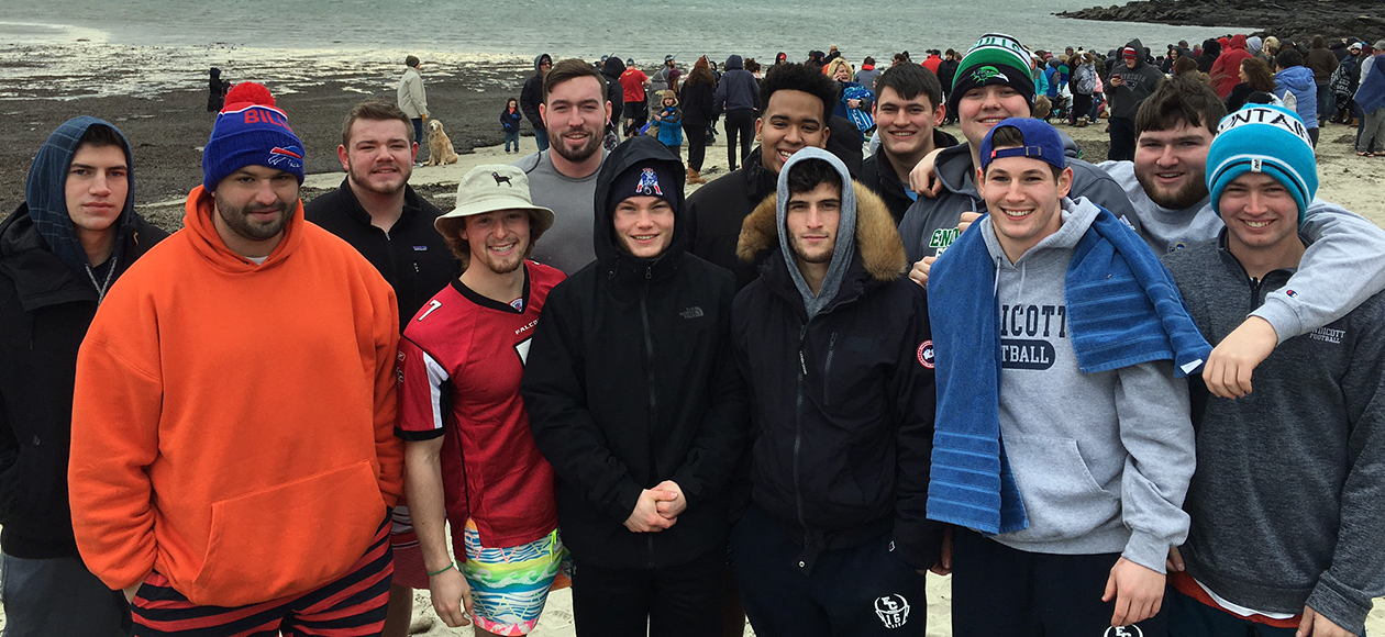 The Endicott football team poses at The Polar Plunge.
