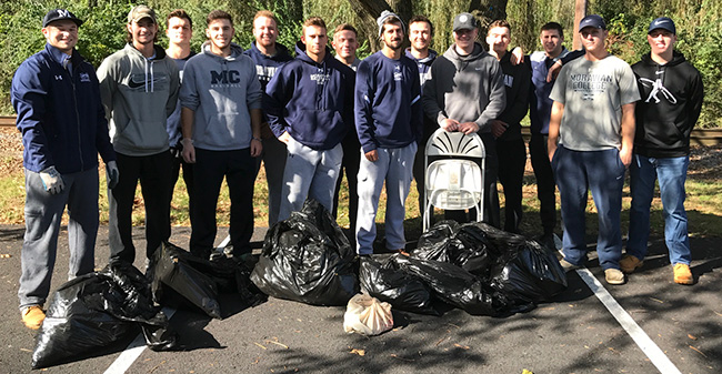 Members of the Moravian College baseball team with the trash collected from cleaning up around Monocacy Creek.