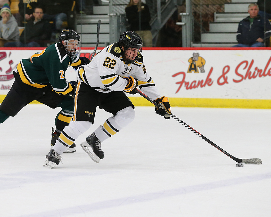 Connor Armour in action against the St. Norbert Green Knights. (Action photo by Mike Dickie)