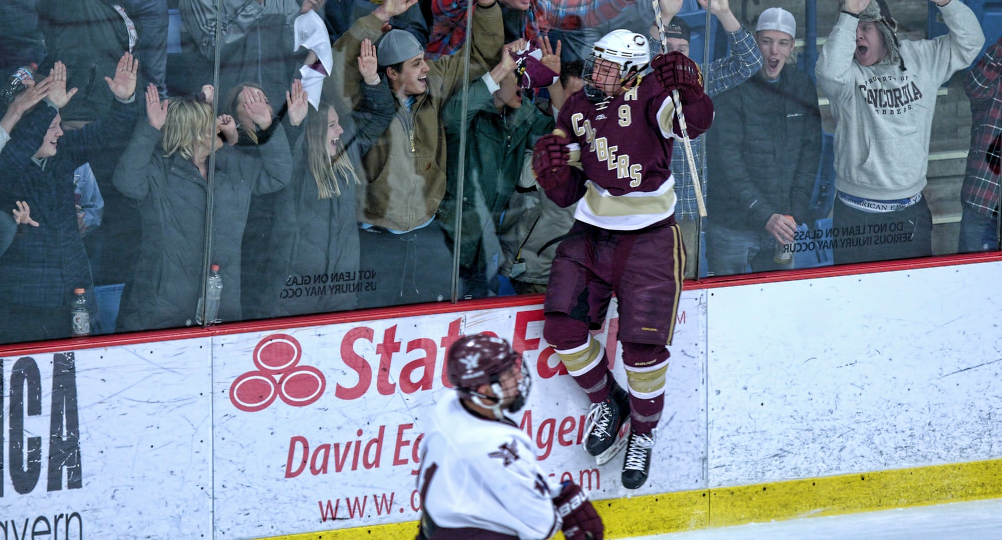 Senior Jon Grebosky jumps into the air to celebrate with the Cobber student section after his second-period goal in the series opener with Augsburg.