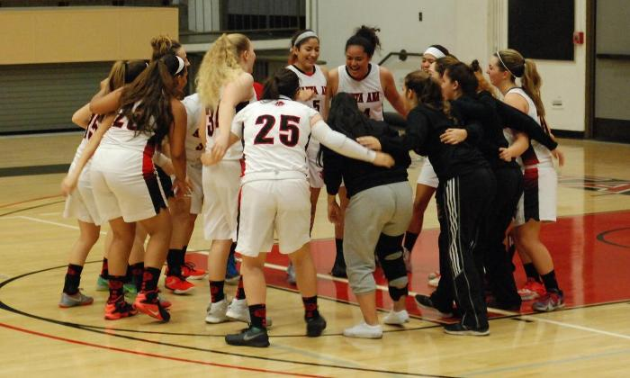 The Dons huddle as a team prior to their 99-61 win over San Diego Mesa College in their host tournament.