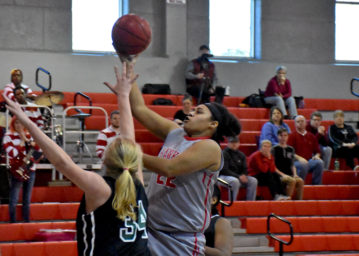 Mia Hudson had a team-high nine rebounds and eight points in Saturday's win over Trinity College (Florida).