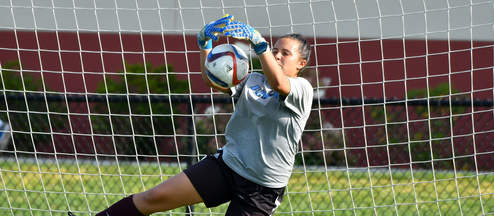 Action photo of Lyons goalie Maria-Lucia Delgado.