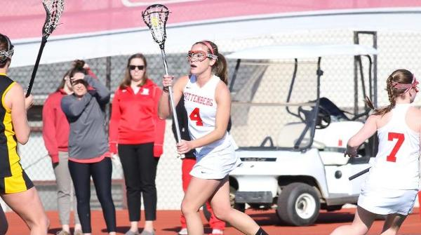 Megan Loofbourrow (4) scored four goals on four shots in the Tigers' 17-12 win over Kenyon. File Photo | Erin Pence