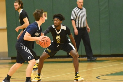 Men's basketball falls in conference opener