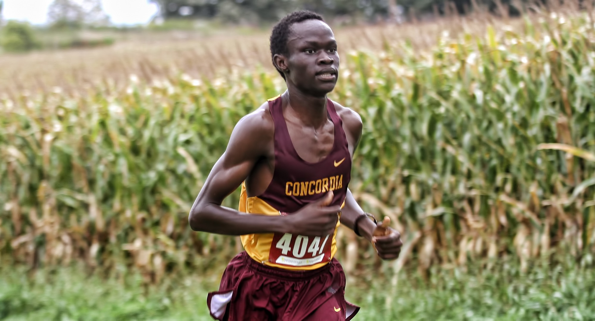 Junior Munir Isahak pulls away from competitors during the Carleton Invite on his way to posting a Top 10 finish. (Photo courtesy of St. Thomas SID)