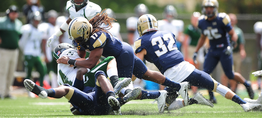 A Gallaudet defender makes a tackle on Greensboro's quarterback during Saturday afternoon's football game at Hotchkiss Field.