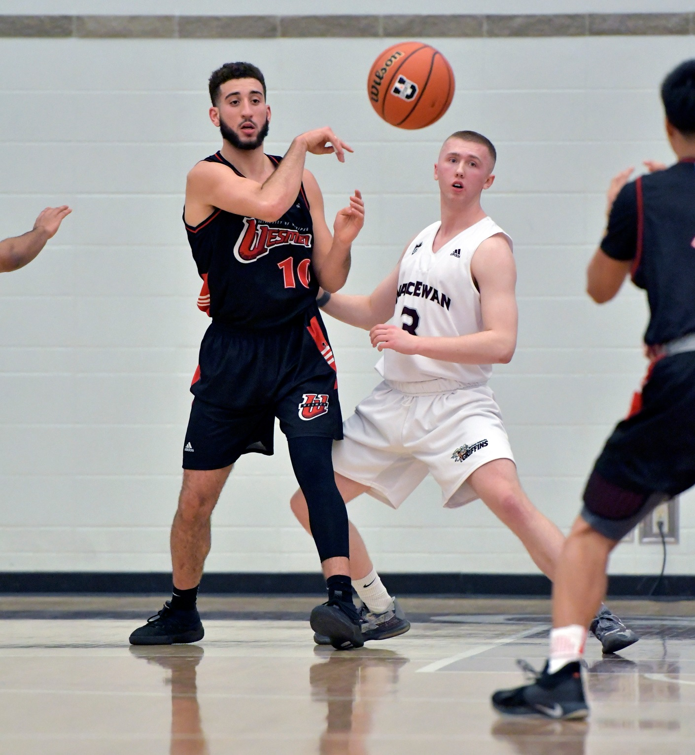 Winnipeg's Adam Benrabah makes a pass out of the post during the Wesmen's win over the MacEwan Griffins, Friday, November 9, 2018 in Edmonton, Alta. (Chris Piggott/MacEwan Athletics)