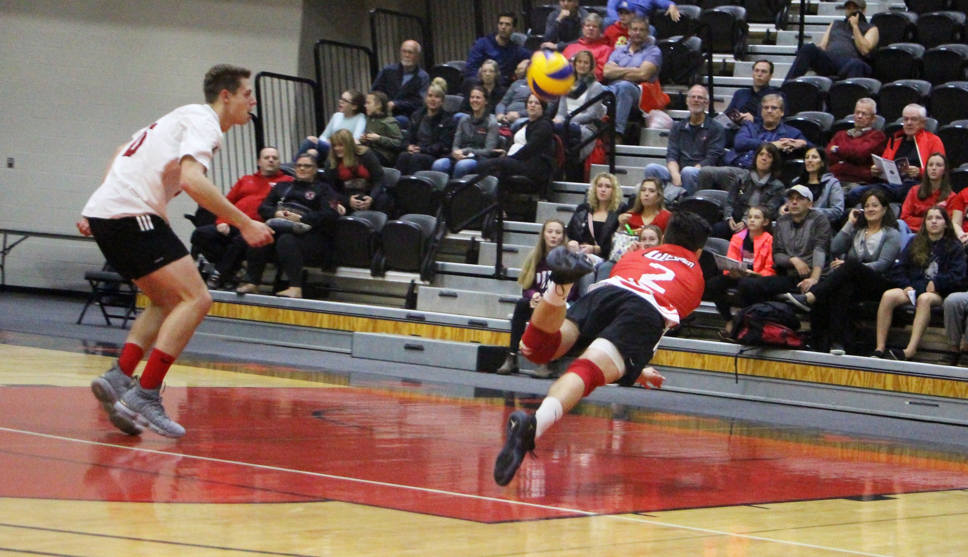 Darian Picklyk lays out to chase down a loose ball during the Winnipeg Wesmen win over the UNB Reds Wednesday, Oct. 10, 2018 in Fredericton, N.B. (UNB photo)
