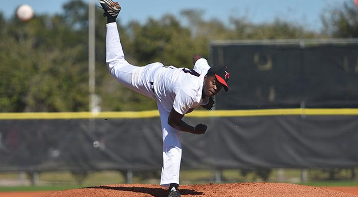Shameko Smith delivers a pitch against the University of Tampa JV. He worked six innings, improving to 2-0. (Photo by Tom Hagerty, Polk State.)
