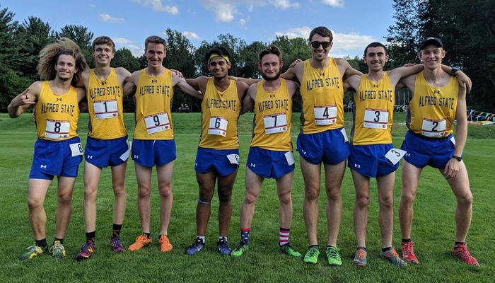 Men's team poses prior to competing at St. John Fisher Invitational