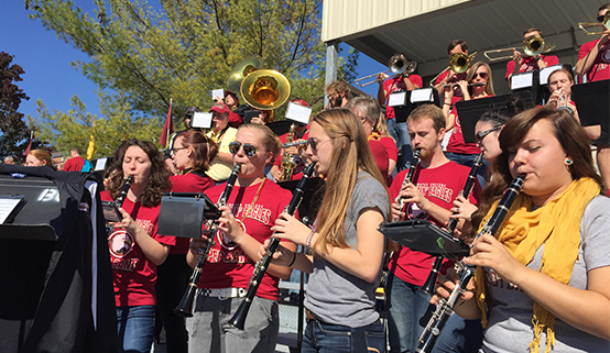 outdoor shot of the pep band performing at jopson field
