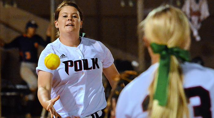 Lauren West flips the ball to Taylor Baker at first base for the final out of game two. West picked up two wins tonight as the Eagles swept South Florida. (Photo by Tom Hagerty, Polk State.)