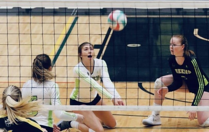 Emma Holmes (11) finished with 7 digs, 6 kills, 4 assists and 1 ace in the win. Picture  - Colby Brochu Photography