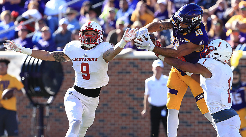 T.J. Josey comes up with the catch between St. John's defensive backs Chris Harris and Max Jackson. (Photo by Joe Fusco, d3photography.com)