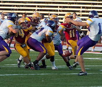 The Bulldogs try to block an Ashland punt attempt (Photo by Scott Whitney)
