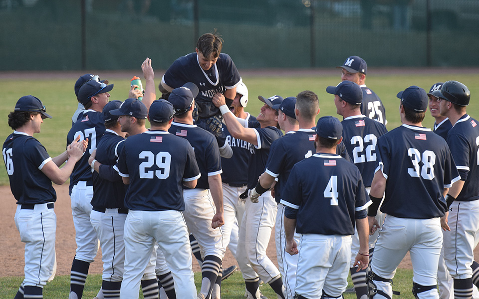 The Greyhounds celebrate after sophomore Michael Miceli scores the winning run in an 11-inning walk-off victory over Susquehanna University at Gillespie Field.