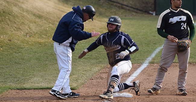Evan Kulig '19 celebrates with Head Coach Paul Engelhardt after a three-RBI triple versus New Jersey City University.
