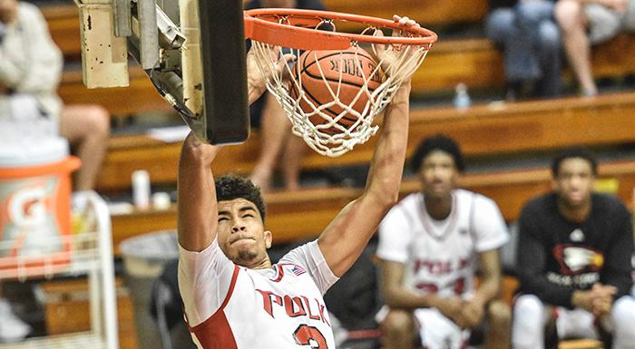 Charles Humphries dunks against Hillsborough in Polk State's 74-47 win.