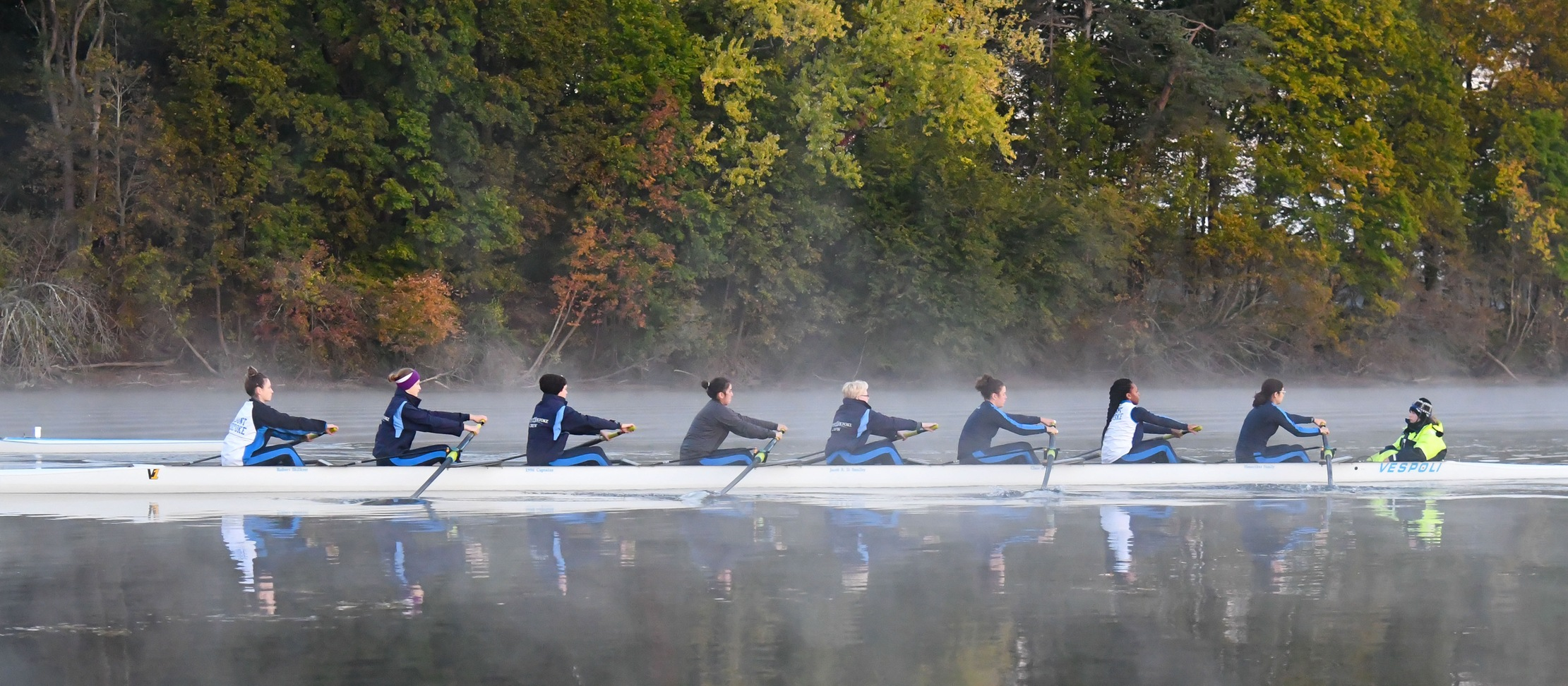 Action photo of the Lyons Varsity Eight boat.