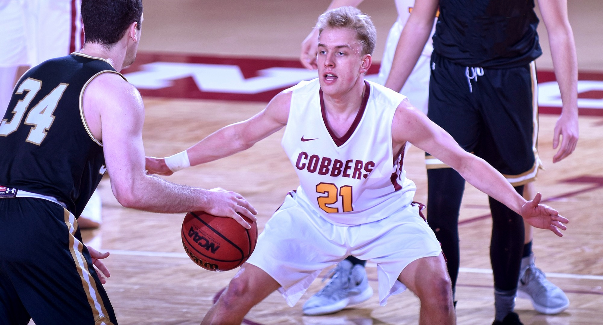 Sophomore David Birkeland scored a career-high 10 points and didn't miss a shot in the Cobbers' game at #4 St. Thomas.