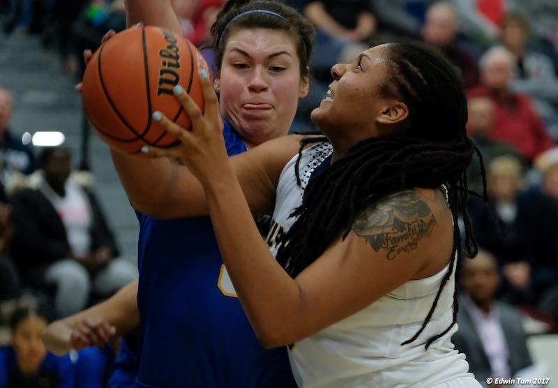 Cheyanne Roger can be seen battling the post to grab offensive and defensive rebounds, or blocking shots for the Windsor Lancers. (Photo credit: Edwin Tam)