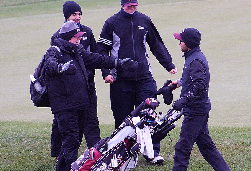 Assistant coach Alan Riley, left, and Griffins teammates greet Justin Berget after he wrapped up a nine-shot win for the ACAC men's individual title on Sunday at Coal Creek Golf Resort (Brody Mark photo, Courtesy SAIT Athletics).