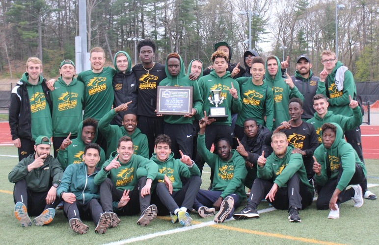 The men's track and field team with their NAC championship awards.