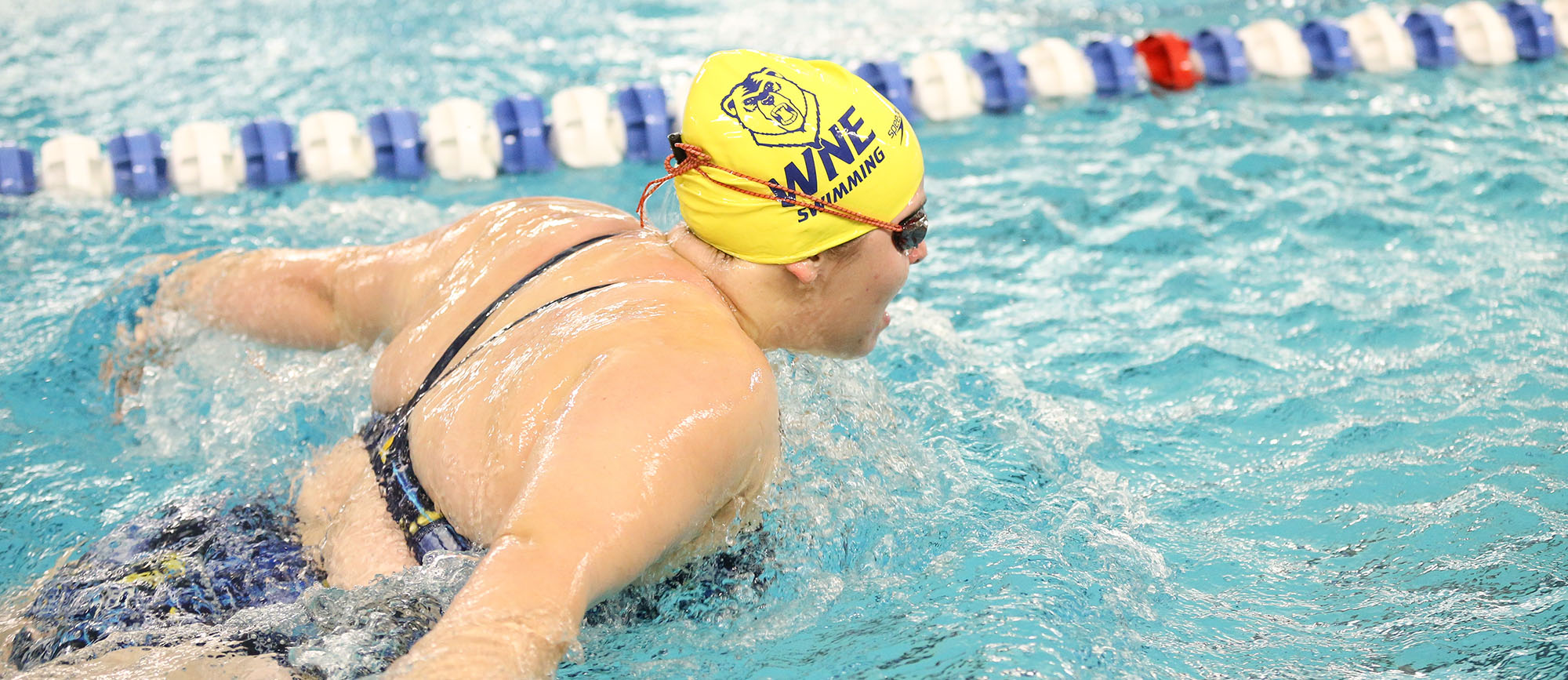 Senior Anna Boucher swam season-best times in three races on Wednesday as the Golden Bears defeated Elms, 148-105.