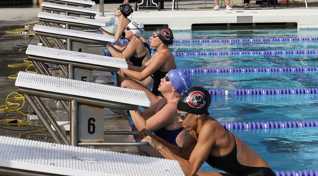 The women prepare to take off for the backstroke.
