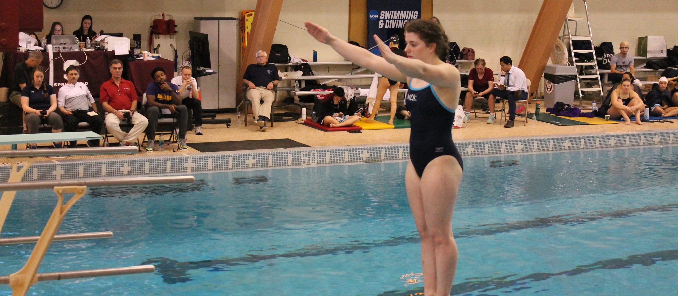 Three Divers Open Competition on One-Meter Board at NCAA Division III Northeast Diving Regionals
