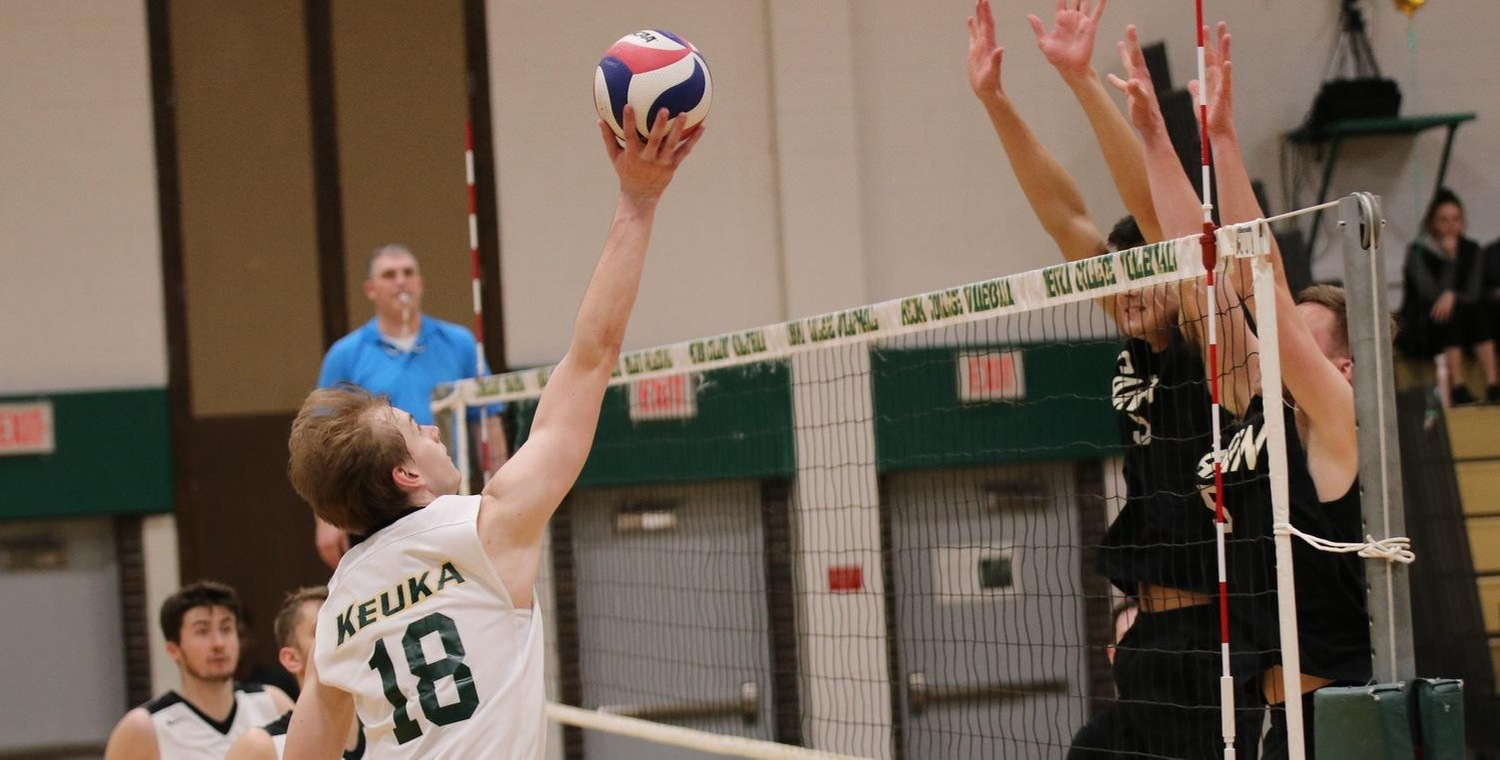 Brad McKnight (18) led the Wolves with eight kills on Saturday