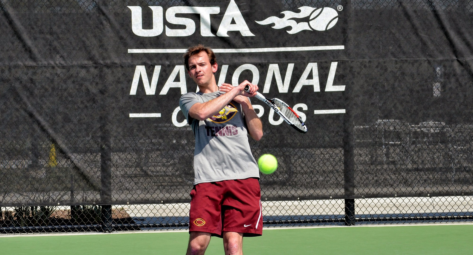 Senior David Youngs hits a forehand during his match at the USTA National Tennis Center. Youngs won his team-leading eighth singles match on Thursday.  (Photo courtesy of Jeff Meyer)