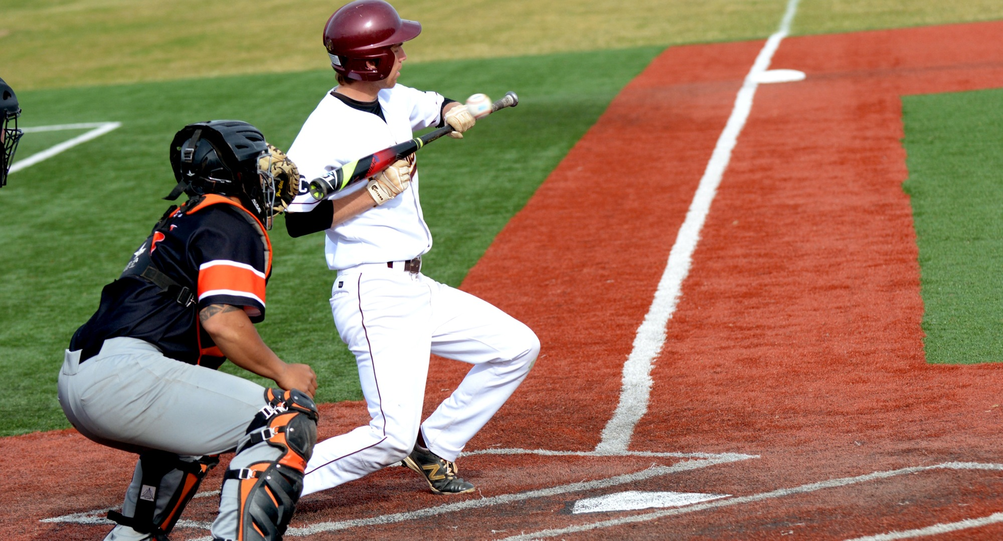 Nate Hoeft ducks and pulls the bat back as he tries to get down a sacrifice bunt during the Cobbers' 10-9 win over Jamestown.