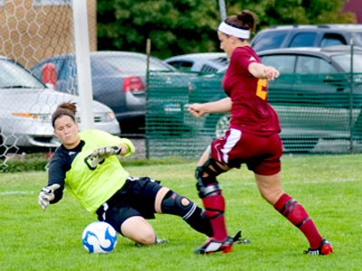 Ferris State's Cassie Aro attempts to score against Findlay goalkeeper Alicia Tutino. (Photo by Glenn Hyde)