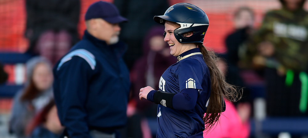 Gallaudet's Kendall Hudson is all smiles after she scores a run for the Bison.